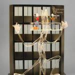 Trophée sculpture moment de vie - Départ en retraite - Trophée d'art et traitement humoristique - Socle en verre noir - Art Verrier